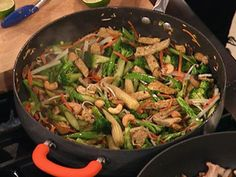 Bob Harper's Stir Fry :: Olive oil, shiitake mushrooms, broccoli, carrots, baby corn, water chestnuts, bean sprouts, garlic, cashews, jalapenos, lime juice and optional quinoa