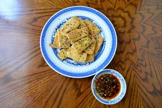 This pan-fried tofu is a really easy way to make tofu. By pan-frying it, you get a nice, slightly crispy texture on it and then dip it in this awesome sauce. We also add chili sauce to give it some spiciness, but if you prefer your sauce mild, you can leave it out.