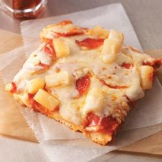 Kickin' Hawaiian Pizza Recipe -Isn't it about time for a fun new twist on your usual pizza? Pineapple adds pizzazz and honey lends a touch of sweetness to the sauce in this wonderful recipe. Give it a try today! —John Weakland, Springfield, Oregon