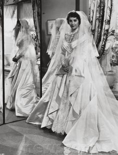 Elizabeth Taylor Dress Auction | Elizabeth Taylor's First Wedding Gown Sells for $188,175 at Christie's