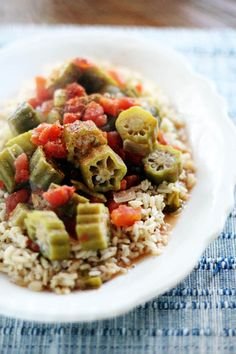 Decidedly Southern, this recipe for Poor Girl's Okra and Tomatoes is the result of too much okra and no bacon. A true (but delicious) story. Made with garden fresh okra and ripe tomatoes, this is my kinda side. Southern Side Dishes, Side Dishes Easy, Vegetable Side Dishes, Southern Recipes, Okra Recipes, Cooking Recipes, Okra And Tomatoes, Vegetarian Recipes, Healthy Recipes