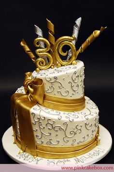 Gold Topsy 30th Birthday Cake by Pink Cake Box in Denville, NJ.  More photos at http://blog.pinkcakebox.com/gold-30th-topsy-turvy-cake-2009-12-10.htm  #cakes