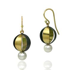 """""""Spherical Earrings""""  Gold, Silver, & Pearl Earrings  Created by Keiko Mita - The open globe earrings are made with 18K yellow gold, oxidized sterling silver, and accented with a 6mm freshwater pearl. $730.00"""