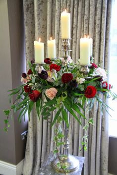 Valentines Day Wedding at Ribby Hall Our Beautiful Baroque Candelabras were dressed with Tulips, Sweet Avalanche, Grand Prix & Black Baccara Roses with fresh Orchids, Astilbe and Par Excellence Gypsophillia