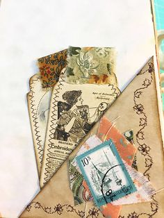 """This junk journal was made using a Manila envelope and measures approximately 6"""" x 9"""". There are 96 pages front and back that consist of coffee-dyed paper, vintage wrapping paper, vintage wallpaper, vintage sheet music, children's writing paper and more. There are numerous fabric"""