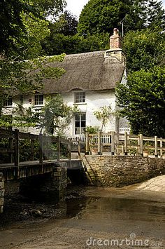 Thatched cottages in Helford Village, Cornwall, England