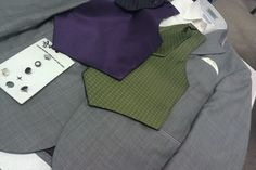 What the guys will be wearing. Gray tuxes, ivory shirt/pocketfold, and vests. Green for groom and purple for the guys. He picked it!