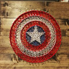 Captain America's famous shield! #marvel #stringart #diy #Captain #America #shield #art
