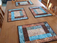 placemats  I like these and they are simple.  These are quilted with circles but they could be spiraling rectangles too.