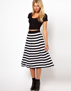 stripe midi skirt...  I wouldn't wear boots with this though.  Ballet flats would be perfect!