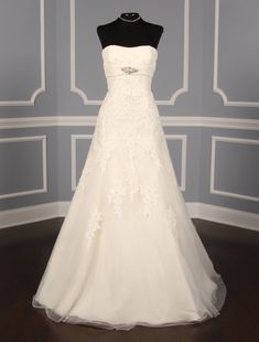 This gorgeous Pronovias Petalo wedding dress is so beautiful in person! The incredible lace wedding dress is made from ivory tulle with beaded lace appliques.