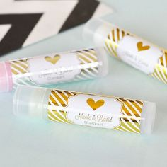 Personalized gold or silver foil stickers are affixed to these lip balm tubes