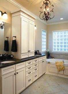 Traditional Full Bathroom, antique white vanity, granite countertops, Kohler Tub, Delta Faucet.