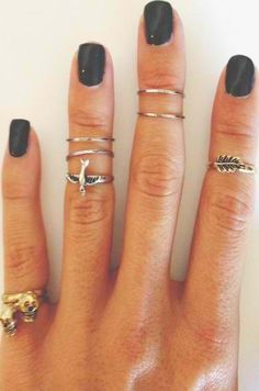 Knuckle rings. This girl got some freaking creepy edward scissor hand fingers. Look at the middle one