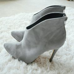 """Suede High Heel Boots in Grey Sexy boots with stiletto height features beautiful grey suede, easy wear with zippers at back of heels. Pointy toes. 4.5"""" heel height. Approx 1"""" platform. Brand new. Boutique Shoes Heeled Boots"""