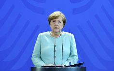 Merkel vows 'more decisive action than ever' on climate   By AFP        German Chancellor Angela Merkel gives a statement where she pledge...