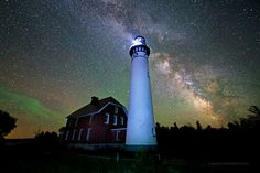 Photo of the Au Sable Lighthouse at the Pictured Rocks National Lakeshore and the Milky Way by Shawn Stockman-Malone for LakeSuperiorPhoto.