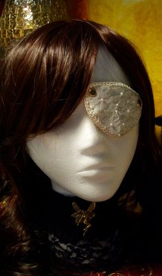 Sexy eye patch for costume or lingerie.  Now the Michelle Rodriguez in Machete movies made eye patches cool again.   Can be white on white, ivories , red with black lace or all blacks https://www.etsy.com/listing/164759071/steampunk-goth-eye-patch-satin-and-lace?