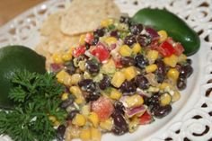 This is my version of the tex-mex black bean with corn salad.  It is a great refreshing summer salad, high in healthy fats.  Note:  Cook time is for refrigeration.