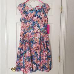 "NWT Betsey Johnson Multi Pink Jersey Flare Dress NWT Betsey Johnson Floral printed Jersey Flare dress.  Size 10 Measurements:  17"" Chest 15"" Waist 37"" Length Betsey Johnson Dresses Midi"