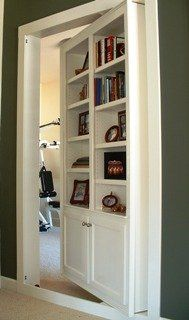Absolutely love this built in! Cool door idea alternative to dining room/workout room