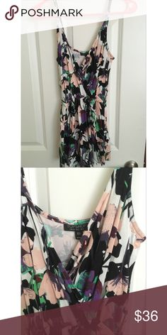 Topshop romper Topshop floral romper. Size 2, fits true to size. Normal signs of wear. Topshop Dresses