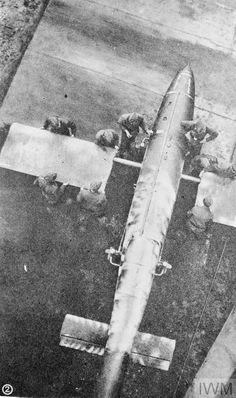 German personnel fitting the wings to a Fiesler Fi 103 flying bomb at a launching site.
