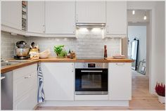 A Chic White Kitchen with Wooden Worktop