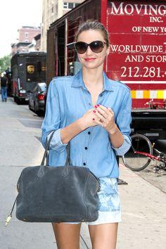 Miranda Kerr carries a grey suede Balmain x Aurelie Bidermann Pierre Bag