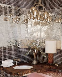 bathroom. mirror tiles. awesome light fixture. wooden counter top.