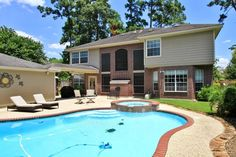 Listing Price: $399,900 Address: 6019 Riverchase Village Dr KINGWOOD, Texas 77345 Bedrooms: 5  Full Baths: 3  Partial Baths: 1 Square Feet: 3,607 Wideplank,distressed hardwood floors.Two Story Den w Stone Fireplace,windows view sparkling pool/spa.Gourmet Kitchen features stained cabinets,corian,black appliances,brk bar.Master suite down w hardwoods,updated bathroom.Spacious gameroom,2 Bedrooms have balconies.Plantation Shutters,3 Car Oversized Garage.Up A/C-7/2015.Water Heater-2014.