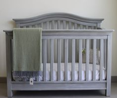 A beautiful whitewashed and greywashed finish with Chalk Paint® decorative paint by Annie Sloan in a combination of French Linen, Paris Grey and Old White on a crib | By stockist Kalology Studio of Austin, TX