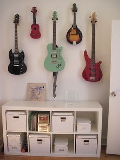 Music wall - his bass, acoustic, and electric, my mandolin and violin.
