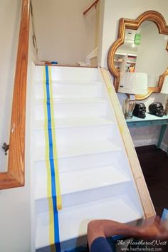 INCREDIBLE stair makeover with PAINT! SO much cheaper than stain or new stairs! If you can hold a paintbrush, you can easily learn how to paint stairs! Painted Staircases, Wood Staircase, Painted Stairs, Staircase Design, Porch And Patio Paint, Stair Layout, Timber Stair, Staircase Storage, Staircase Remodel