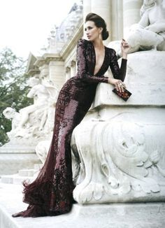 Love the undo.. formal.. gorgeous.. bold.. but still understated.. also ads a couple inches to your height.. PS.. Stunning dress