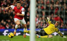 Inevitable: Giroud takes control of the ball as Boruc is left slumped on the Emirates turf