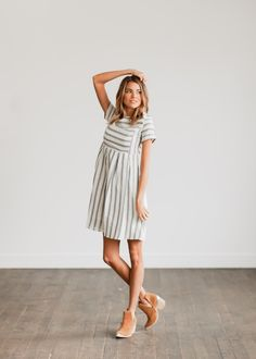 DETAILS: - Blue and white striped dress - Fully Lined - Knee length - Model is 5'9 wearing a small ***Note: Stripes look grey in photos but are blue***