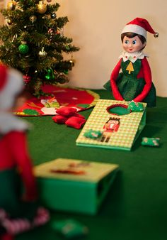 Elf on the Shelf Ideas. The elves are playing a game of Christmas cornhole. To view more pins like this one, search for Pinterest user amywelsh18.