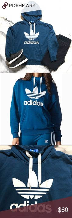 {adidas} Teal Originals Trefoil Hoodie This classic adidas hoodie is going to become a staple in your closet for casual days or post workout sessions.  🔹 Beautiful teal color with white logo 🔹 French Terry material 🔹 Measures 23 inches across chest (armpit to armpit) 🔹25 inches laying flat from shoulder to bottom edge 🔹Hits at hip adidas Tops Sweatshirts & Hoodies