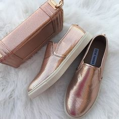 New Steve Madden sneakers Brand new never worn Steve Madden slip ons Super stylish and cool metallic rose gold color. size 6.5 true to size. Definitely eye catching. Matching bag also available for $40 Steve Madden Shoes Sneakers