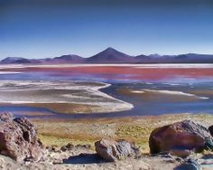 This eerie lake in Bolivia has blood red water and is dotted with strange white islands made of borax, the same stuff used in many detergents.