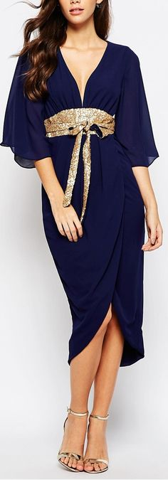 Black kimono sleeve with gold obi belt dress. Want. Bad.
