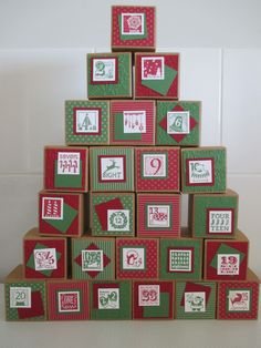 Advent Calendar - made using Stampin' Up Tiny Treat Boxes, Cherry Cobbler and Garden Green cardstock and DSP and 25 & Counting stamp set.