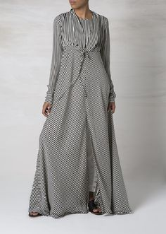 """<div class=""""page"""" title=""""Page 6""""> <div class=""""section""""> <div class=""""layoutArea""""> <div class=""""column""""> <p><span>A light free flowing Abaya which can be tied up at the waist. The stripe Abaya incorporates a slit at the side for a chic look.</span></p> </div> </div> </div> </div>"""