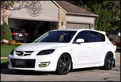 Love this black and white. Rims and light tints (headlights and brake lights) need to match. Black Rims, White Rims, Mazda Hatchback, Mazda 3 2004, Mazda 3 Sport, Custom Headlights, Headlight Covers, Mazda Cars, First Car