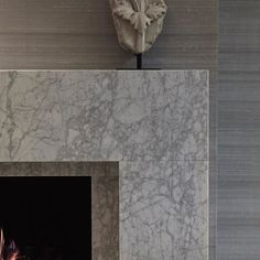 I love adding a fireplace in our interior schemes, they work in almost any room - from kitchens, bathrooms, outside on the terrace, to formal living and dining rooms. They create atmosphere and are a much more elegant focal point than a TV. I like to source soft and relaxed marble, often in a honed finish which is a more pared back look thank highly polished marble. This particular slab was sourced from Italy and works perfectly to compliment the silk wallpaper backdrop. #details #fireplace…
