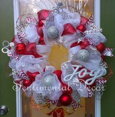This red and white Christmas wreath will remind you of a peppermint candy, and is sure to bring all of your guests joy! It is made with white