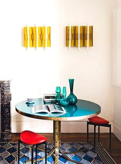 Dining nook with turquoise table and vases