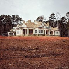With final grading taking place, the water side of our middle Georgia lake house is finally more visible... sitting proudly at the crest of its hill, taking advantage of nearly 180 degree water views. #paintitwhite #lakehouse #design #middlegeorgia @jonathanbussell @ashleygilbreathinteriordesign @kingdomwoodworks
