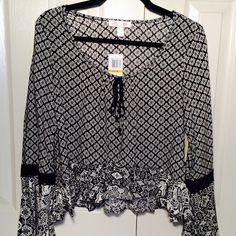 """NWT Zoe & Rose Boho Peasant Top New with tags. Gorgeous boho top by Zoe & Rose!  Easy oversized styling!  Fun black and white design, with awesome crochet detail on full bell sleeves. Machine washable. True to size. 21"""" long. Size Medium.  No trades. Price firm. Boutique Tops"""